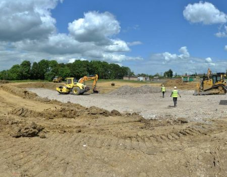 Diggers commencing grounds works at Warth Park Industrial Estate